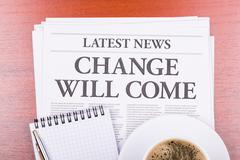 the newspaper  change will come  and coffee - stock photo