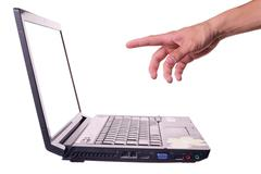 Stock Photo of hand and laptop