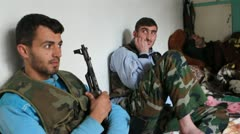 Free Syrian Army fighters in safe house Stock Footage
