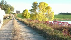 Running Down Dirt Road in Fall Stock Footage