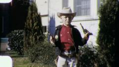 BOY SHOOTS TOY GUN Cowboy Costume 1950s (Vintage Film Retro Home Movie) 5941 Stock Footage