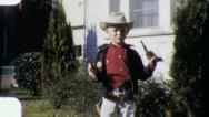 Stock Video Footage of BOY SHOOTS TOY GUN Cowboy Costume 1950s (Vintage Film Retro Home Movie) 5941