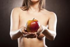 nude girl with apple - stock photo