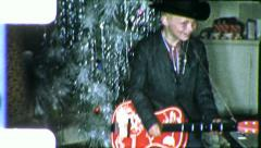 ROCK STAR CHRISTMAS Boy Plays Guitar Cowboy 1950s Vintage Film Home Movie 5943 Stock Footage