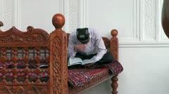Uzbekistan muslim sitting on a divan Stock Footage