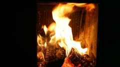 Fire burning in a wood stove Stock Footage
