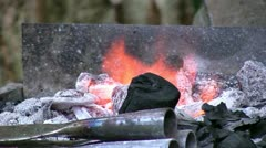 Rudimentary forge at medieval reenacment close up Stock Footage