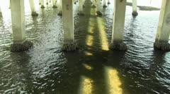 Sunlight through bridge gap Stock Footage
