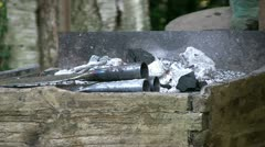 Rudimentary forge at medieval reenacment Stock Footage