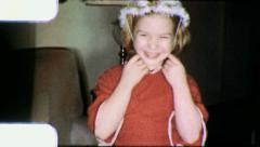 Cute Girl Puts On Hat 1960s Vintage Film Retro Old Home Movie 5954 Stock Footage