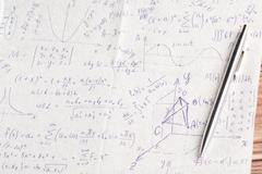 Mathematical calculations on a napkin Stock Photos
