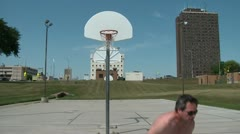 Two Men Playing One on One Basketball Stock Footage