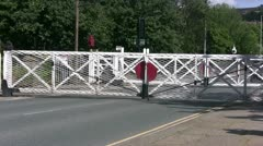Zoom in on opening level crossing gates Stock Footage