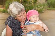 Senior woman with little granddaughter Stock Photos