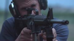 Young man shooting AR15 at range Stock Footage