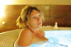 woman in bath - stock photo
