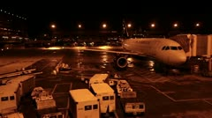 Airport ramp aircraft prepare for flight Phoenix night HD 4590 Stock Footage