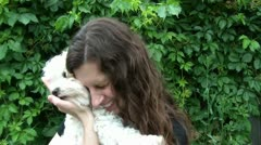 Woman Hugging Small Dog Stock Footage