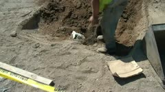 Worker Digging Hole in Sun Stock Footage