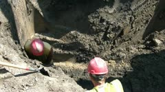 Worker Probing Ground in Hole Stock Footage