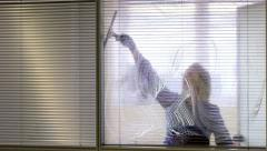 Professional maid cleaning and wiping window in office with soap - stock footage