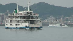 Sailing Japanese ferry with Kagoshima city in the background Stock Footage