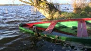 Wooden boat in autumn lake Stock Footage