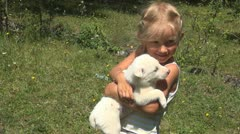 Child Embracing and Kissing Puppy, Small Girl Playing with Dog, Animal, Children Stock Footage