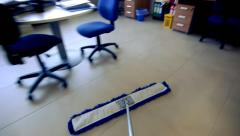 Timelapse of professional cleaner wiping floor with broom in office Stock Footage