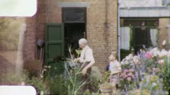 GRANDFATHER and Boys Grandsons in Garden 1960s Vintage Film Home Movie 6001 Stock Footage