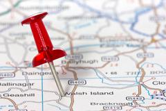 pushpin showing the location on a map - stock photo