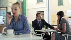 Young business people chatting during coffee break in cafe HD Stock Footage