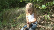 Child Playing with Leaves on a Mountain Path, Little Girl Resting and Having Fun Stock Footage