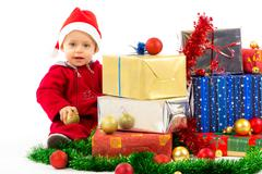baby with christmas gifts - stock photo