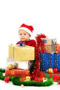 Stock Photo of baby with christmas gifts