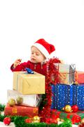 Baby with christmas gifts Stock Photos