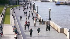 London Flow Of People next to river Thames: Timelapse Stock Footage