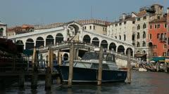 Rialto Bridge in Venice, Italy, people,  boats, ships and gondolas trip, tour Stock Footage