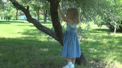 Child Playing with a Tree Bark, Little Girl Near a Tree in Park Stock Footage