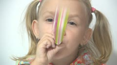 Child's Party, Little Girl Playing with a Blowout, Kids Party Stock Footage