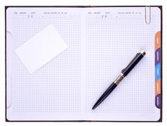 Notebook, pen and paper clip Stock Photos