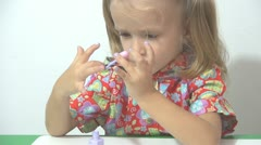 Little Girl Painting her Nails with Polish Nails, Girl Playing With Polish Nails Stock Footage