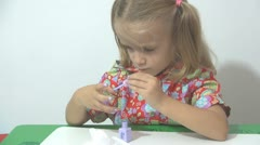 Little Girl Painting her Nails with Polish Nails, Girl Playing With Polish Nails - stock footage