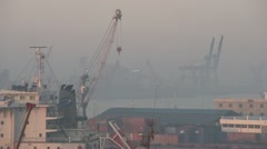 Egypt, Port Alexandria port and cranes, hazy sky, slow dolly Stock Footage