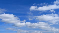 White clouds flying on blue sky. Timelapse. - stock footage