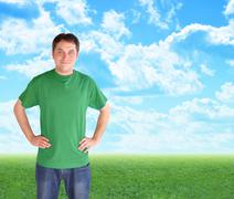 green nature man standing in clouds and grass - stock photo