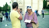 Attractive young female tourist studying a map on the street Stock Footage