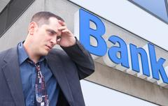 stressed money business man at bank - stock photo