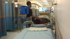 Patient waiting in hospital emergency room Stock Footage