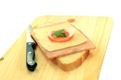 Simple Sandwich over wooden serviette. Stock Photos